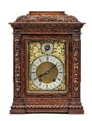 A German oak cased mantel clock, early/mid 20th century, with foliate carved case,
