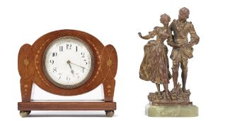 An Art Nouveau style mahogany and inlaid mantel clock, early 20th century, of unusual outline,