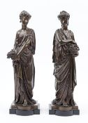A pair of late 19th century bronze female figures,