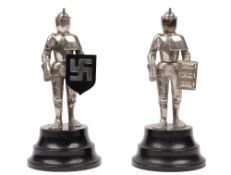 A pair of white figural table lighters, mid to late 20th century,