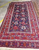 A South Persian soumak rug, the dark indigo field with ivory and madder boteh, birds,
