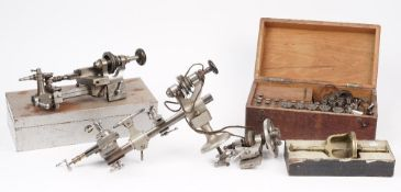 A Horologists steel lathe, a die set and related horological accessories.