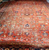 A Mahal carpet, Persian, the madder field with an allover design of bold flowerheads,