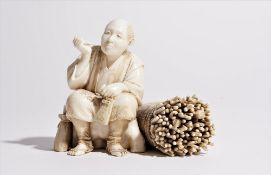 A Japanese ivory okimono of a woodcutter, Meiji/Taisho period,