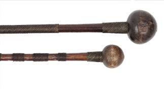 An African knobkerrie, the shaft bound with sections of two tone metal wire, 68cm long,