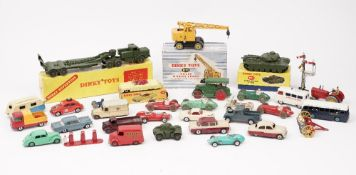 A quantity of mainly Dinky die-cast vehicles including; a 660 Tank transporter, boxed,
