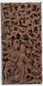Four modern South East Asian hardwood panels, each intricately carved in deep relief,