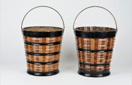 A pair of Dutch part ebonised fruitwood oyster buckets with ribbed bodies,
