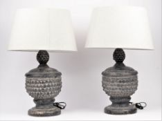 A pair of modern stone effect table lamps,