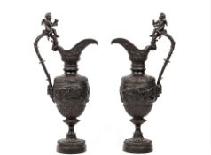 A pair of bronze ewers, after the antique, late 19th century,
