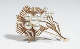 A gold and cultured pearl brooch, of abstract flower design,