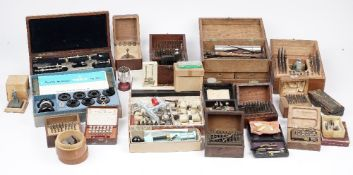 A quantity of Horologists tools and accessories including; depth lathe, die sets,