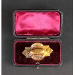 A Victorian 15ct gold brooch, designed a
