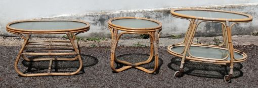 A vintage rattan oval two-tier trolley,