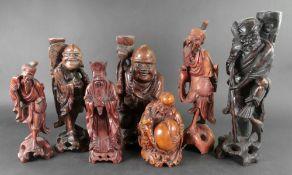 A group of seven Chinese carved wood fig