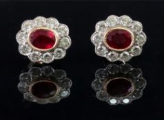 A pair of 18ct gold ruby and diamond-set earstuds of cluster design,