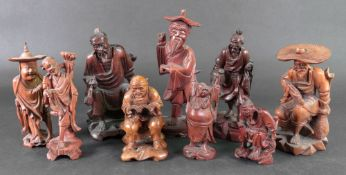 A group of nine Chinese small carved woo
