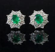 A pair of 18ct white gold emerald and di