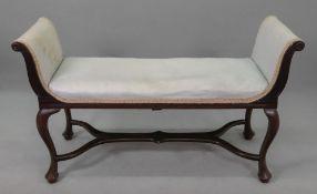 An Edwardian carved mahogany frame uphol