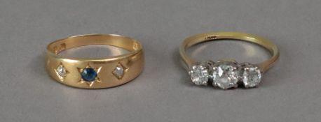 An 18ct gold three stone diamond ring, s