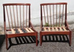 A pair of retro rosewood lounge chairs,