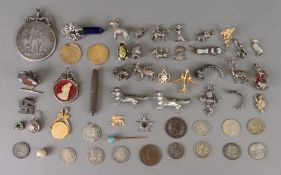 A collection of silver and other charms,