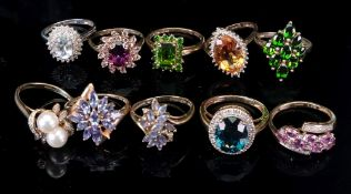 A collection of ten 9ct and gem-set dres