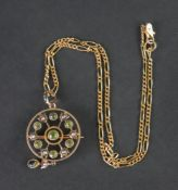 An Edwardian peridot and seed pearl openwork circular pendant/brooch, detailed 9ct, 2.