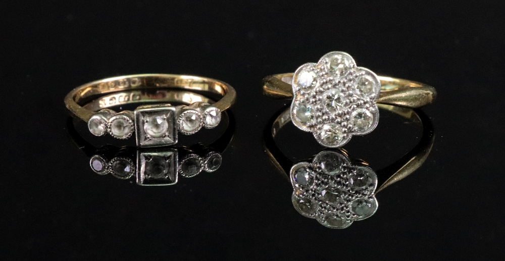 A diamond cluster ring, detailed 18ct an