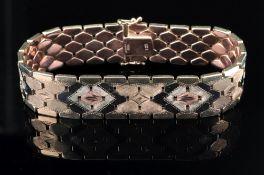 A 9ct tri-gold bracelet of lozenge shape