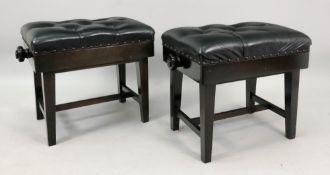 A pair of ebonised frame piano stools, 20th century,