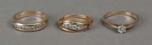 An 18ct gold five stone diamond ring of cross over design, set with mine-cut diamonds,
