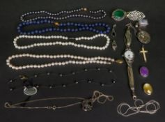 A collection of silver and bead jeweller