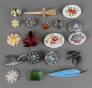 A blue guilloche enamelled leaf brooch,