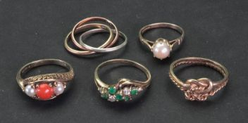 A collection of five 9ct gold and gem-se