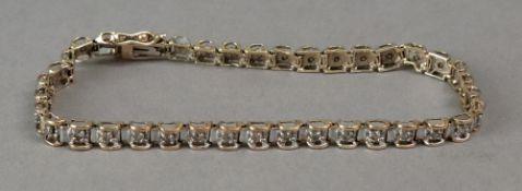 A 9ct gold diamond bracelet, the 39 squa