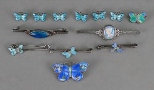 A silver and enamelled butterfly brooch,