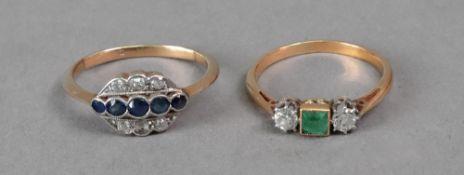 A three stone emerald and diamond ring,