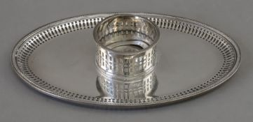 An oval inkstand base, possibly Mexican, by Y.