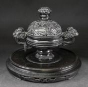 A Chinese black composition two handled censer and cover,