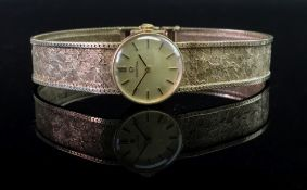 Omega: a lady's 9ct gold cased wristwatc