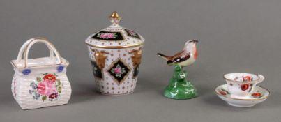 An English porcelain miniature vase, cir