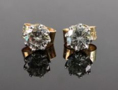 A pair of 18ct gold single-stone diamond earstuds,