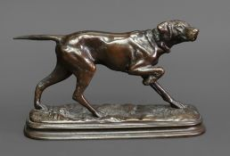 After Alfred Dubucand (1828-1894) A Pointer, standing on a naturalistic base, patinated bronze,