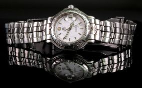 Tag Heuer: a gentleman's 6000 series stainless steel wristwatch, circa 1990s, model number WH1211,