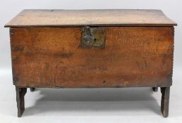 A 17th century oak six plank coffer, with gouged borders and 'v' cut end boards, 106cm wide x 40.