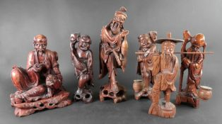 A group of six Chinese carved wood figur