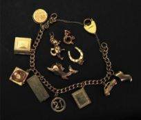 A 9ct gold curb-link charm bracelet, sus