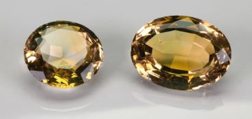 A large unmounted oval mixed-cut citrine and a circular example, 9g gross, (2).