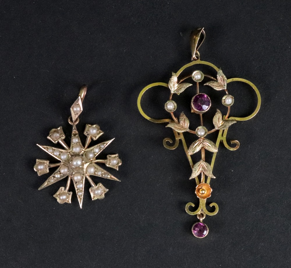 Lot 214 - An Edwardian amethyst and seed pearl set pendant, detailed 9ct, of foliate design, 5cm,